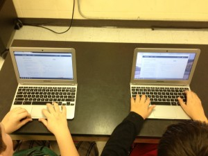Two 6th graders developing a website on web coding.
